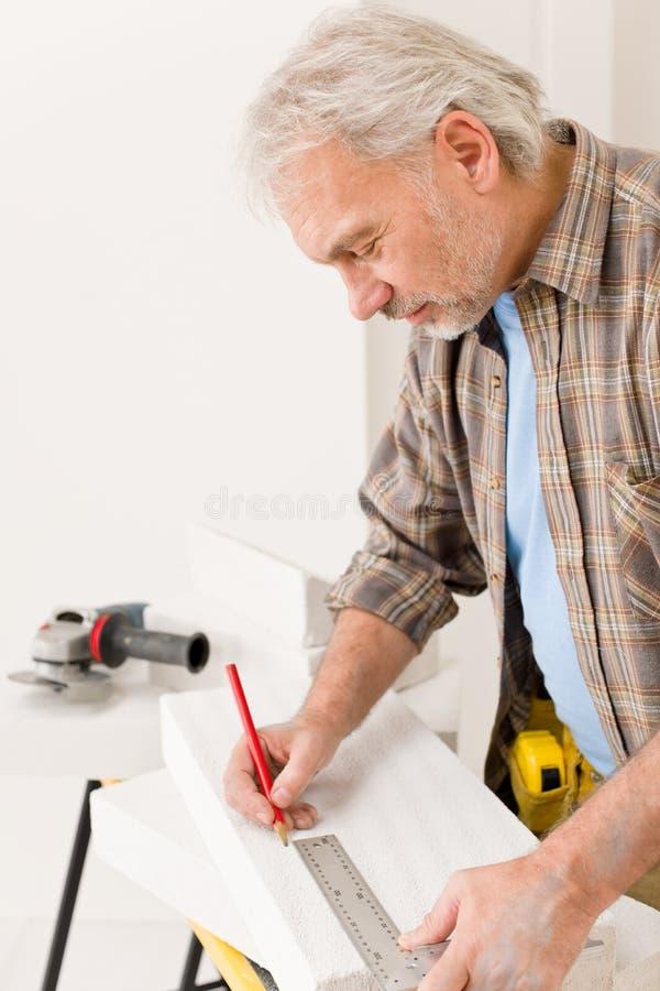 Download Home Improvement - Handyman Measure Porous Brick Stock Photo - Image: 17665144