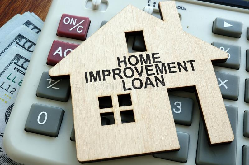 Home improvement loans written on the model of home stock photography