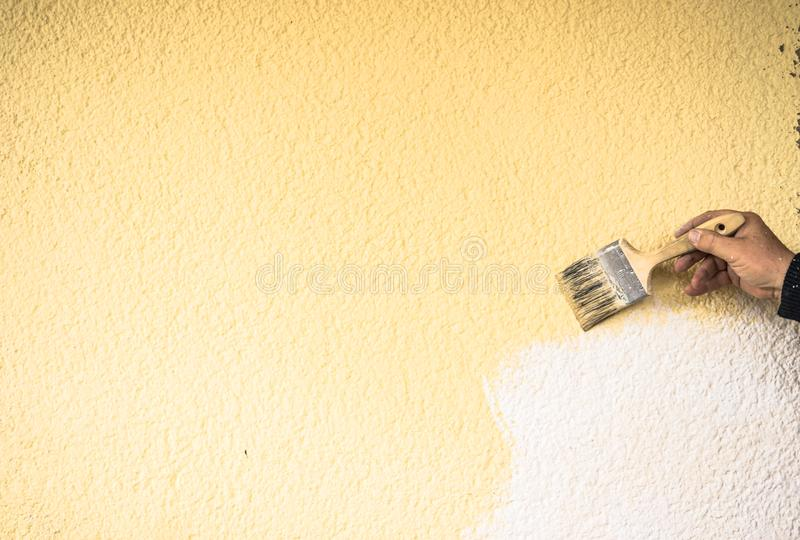 Home improvement, male hand is painting wall royalty free stock images