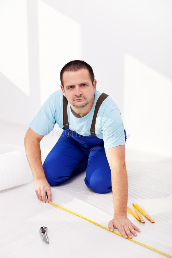 Download Home Improvement - Man Laying Isolating Foam Layer Stock Photos - Image: 22739303