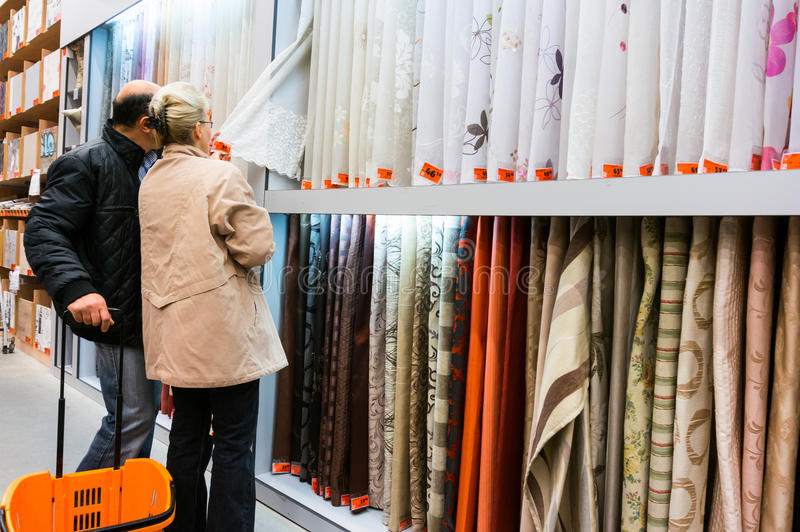 Home improvement store. Customers choosing textiles in Hornbach home improvement store, Romania stock photo
