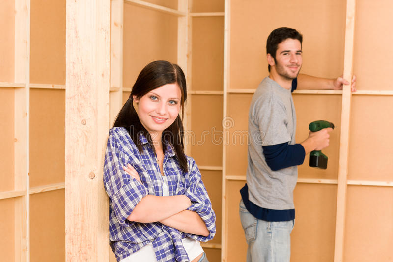 Home improvement young couple fixing wall royalty free stock images