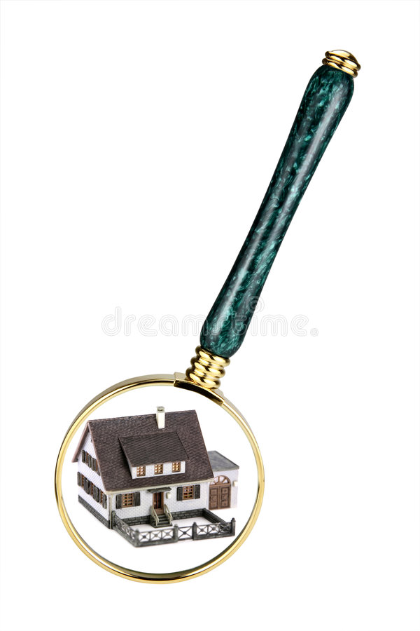 Home inspection concept. A magnifying glass examining a miniature model home. Concept image of a home inspection. Isolated on white stock images