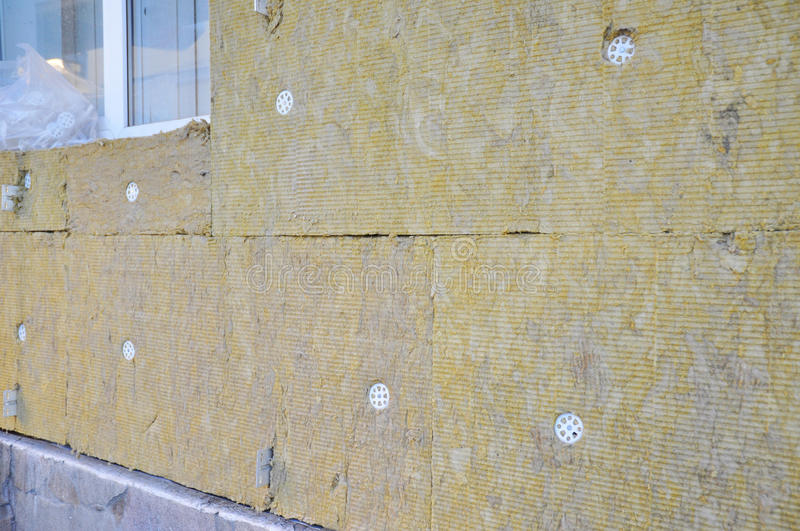 Home Insulation & Reduced Heat Loss for Energy Saving. House insulation cost. Home improvement for House Energy efficiency royalty free stock images