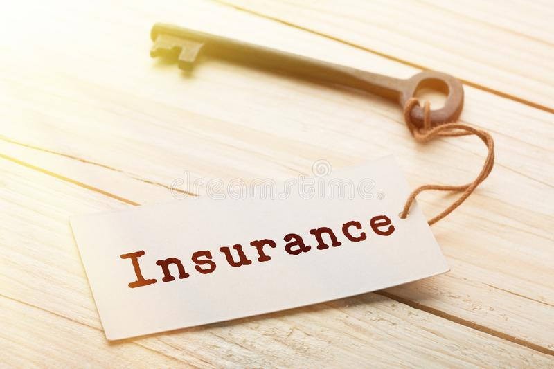 home insurance concept - old key with tag royalty free stock photo