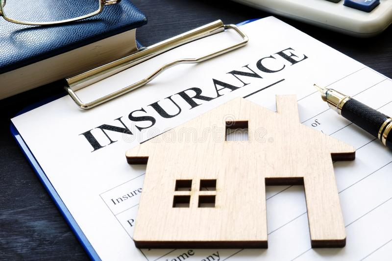 Home insurance. Policy and model of house. Home insurance concept. Policy and model of house stock image