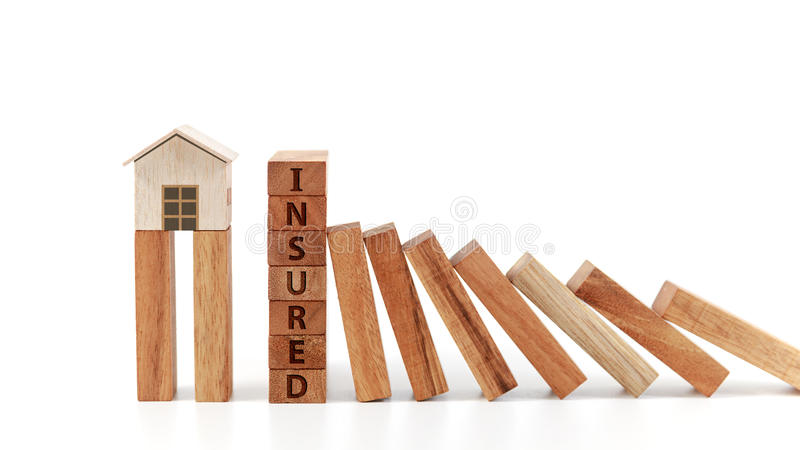Home insurance concept. Wooden model home stock images