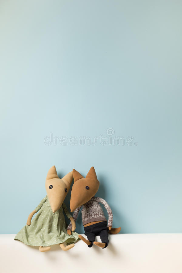 Home interior. Childhood. Blue background. Toy sitting on a couch. Copy space. Home interior. Childhood. Blue background. Toy sitting on a couch. Copy space royalty free stock photos