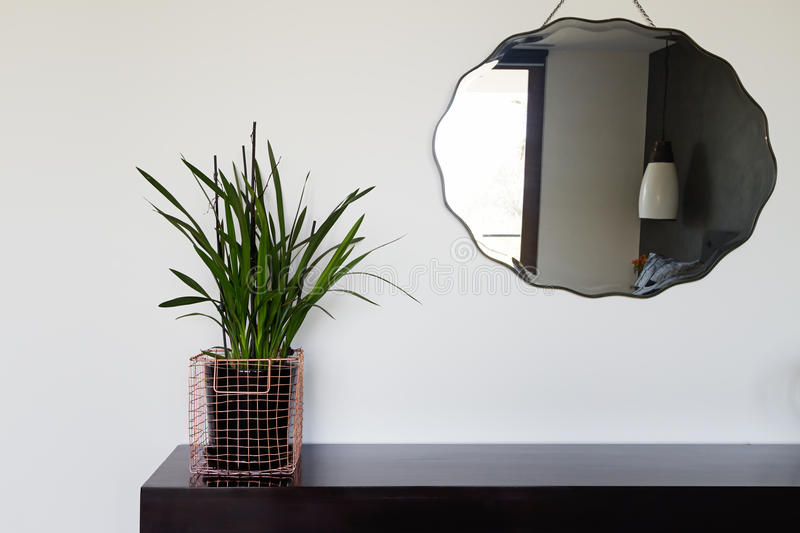 Home interior decor details copper wire basket and mirror royalty free stock image