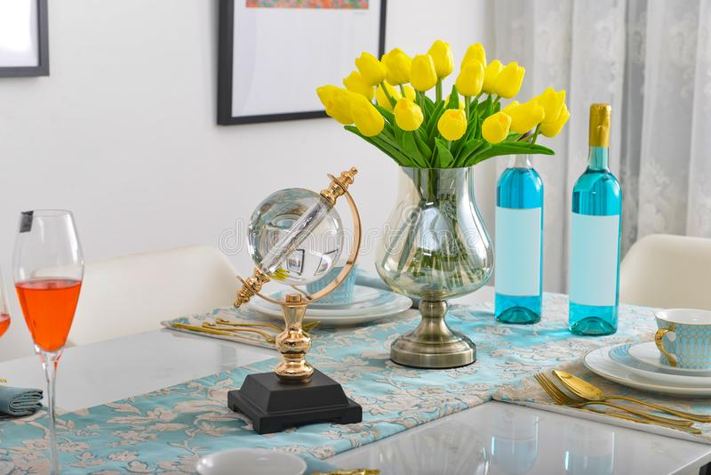 Home interior decor,dining room , bouquet in glass vase royalty free stock image