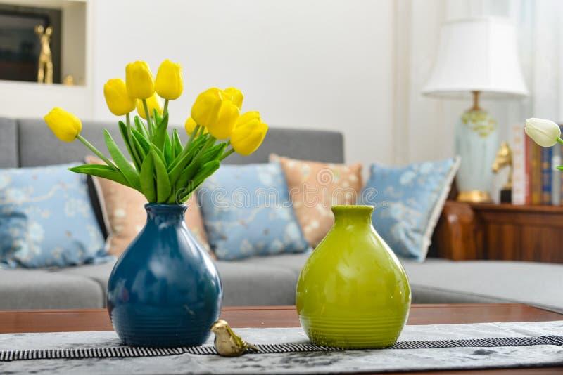 Home interior decor, tulip bouquet in vase stock image
