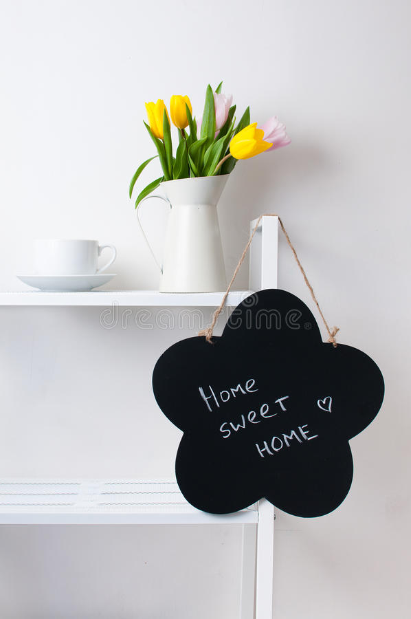 Home interior decoration: a bouquet of tulips, a cup and a chal stock images