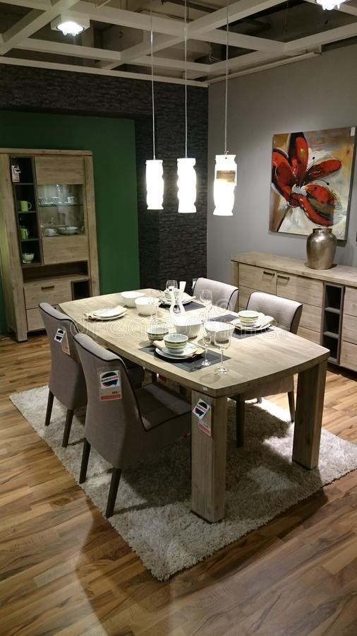 Home interior design: dining area furniture. Interior design for modern homes at a furniture producer showroom stock photo