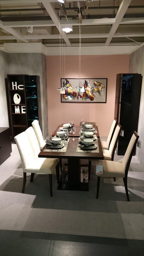 Home interior design: dining area furniture. Interior design for modern homes at a furniture producer showroom stock photos