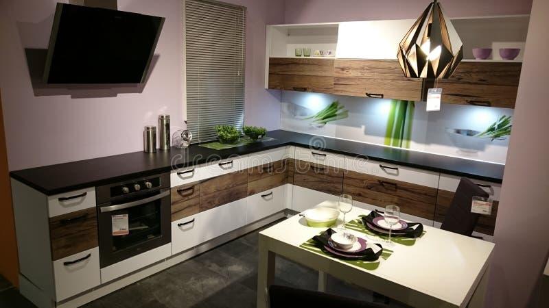 Home interior design: modern kitchen furniture. Interior design for modern homes at a furniture producer showroom stock photo