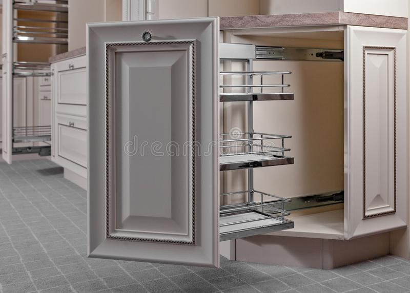 Home Interior. Kitchen - Opened Door with Furniture. Wood and Chrome Material, Modern Design.  royalty free stock photo
