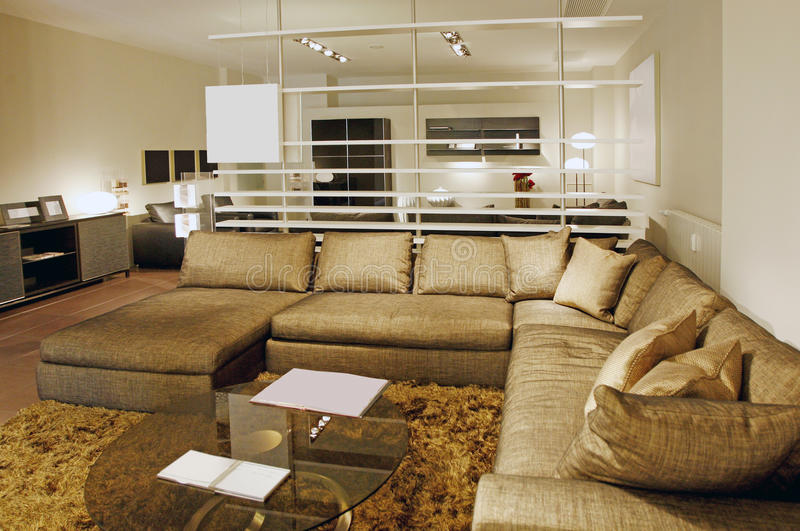 Home interior. Large home interior with couch and coffee table royalty free stock image