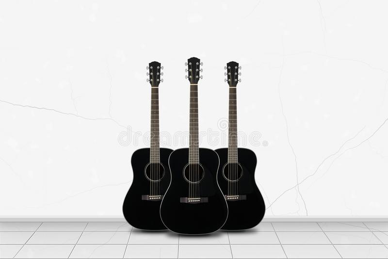 Home interior - Three black guitar in front of white wall stock photo