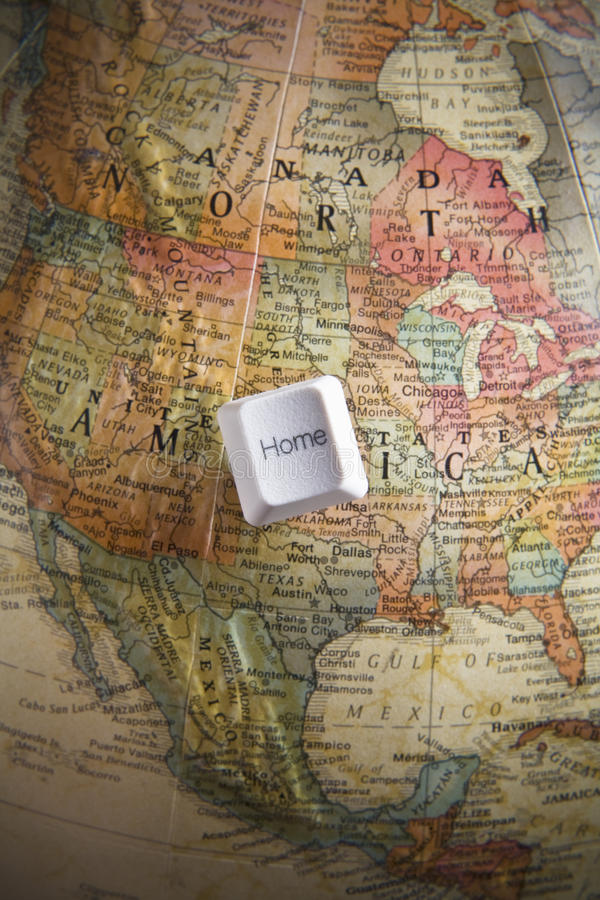 Home key on an earth globe royalty free stock image