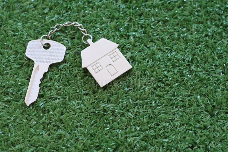 Home key with house keyring on white wood table background, property concept. Copy space keys keychain metal family real estate room black figure empty blank stock photography