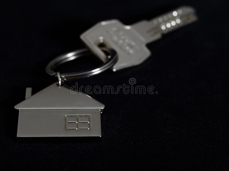 Home key and metal key ring royalty free stock images