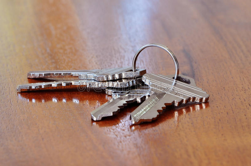 Home keys. Keys to the home on a wooden table stock photo