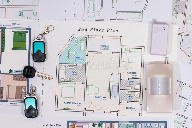 Home keys, cctv with house construction. Concept of alarm system home royalty free stock photography