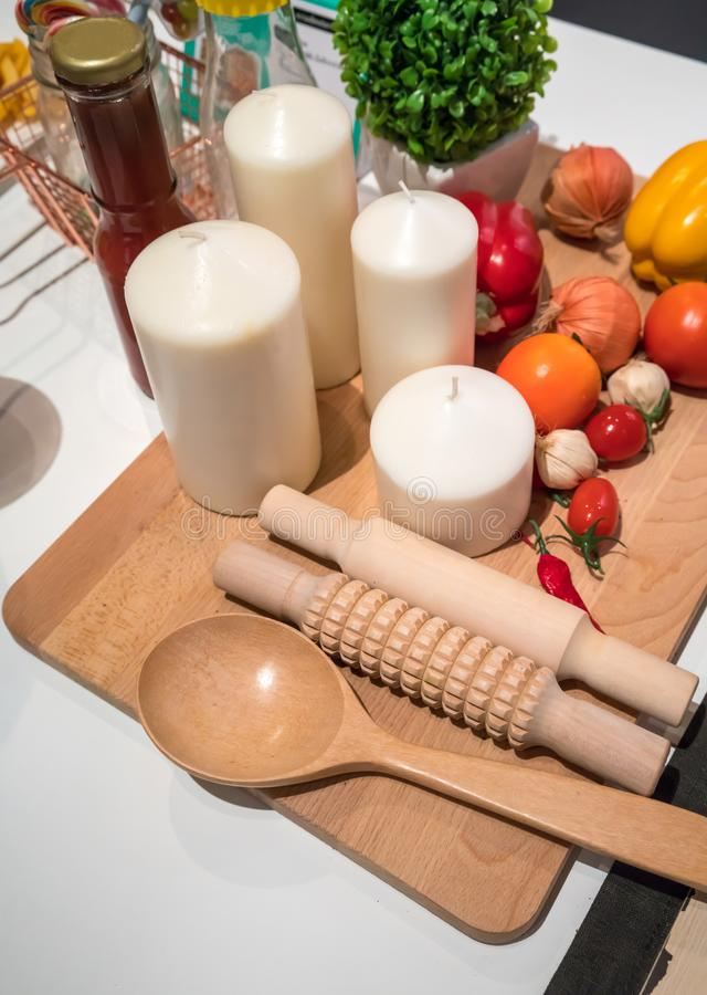 Home kitchen with cooking supplies and fake vegetables on wooden. Board for background royalty free stock photos