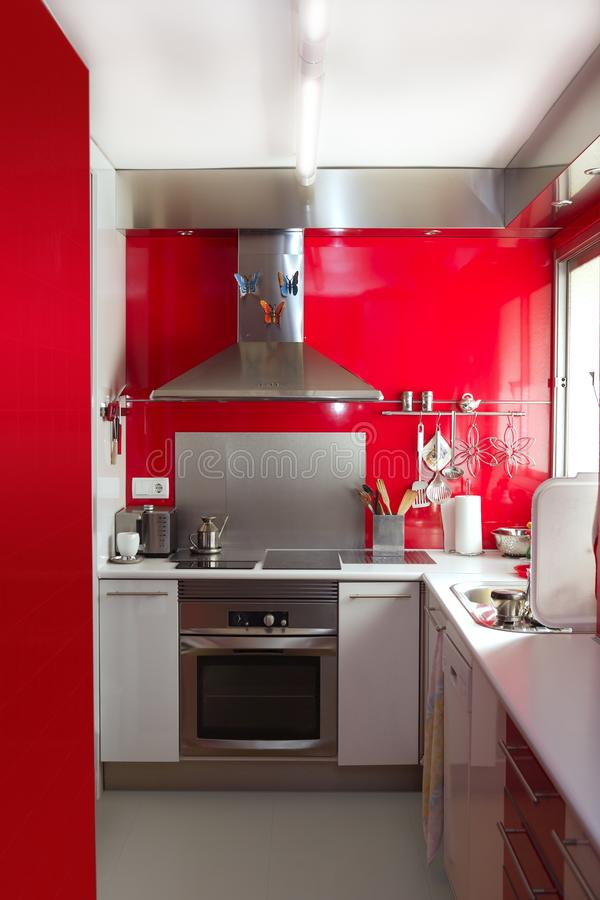 Home kitchen in red colors natural window light stock photos