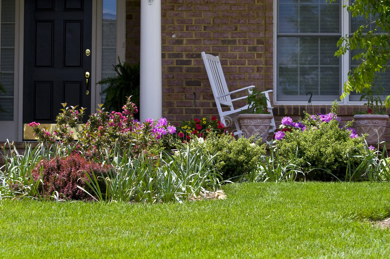 Home Landscaping. Home garden / landscaping with various flowers and other plants royalty free stock images