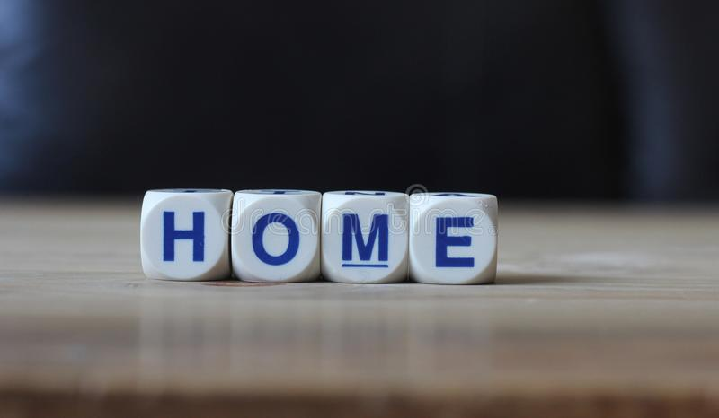Home. Letters cube wordings on wood table royalty free stock photography