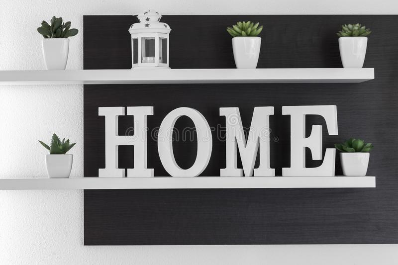 Home letters decor on white shelf royalty free stock photography