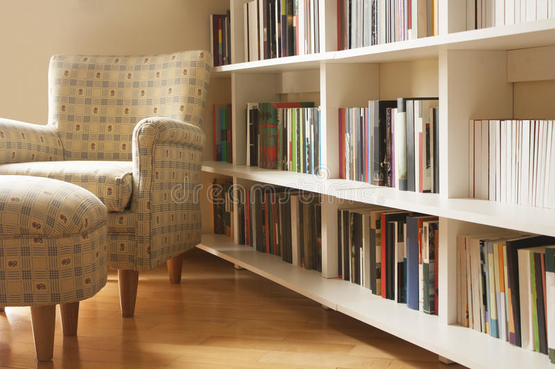 Home library. Modern home library with armchair royalty free stock images