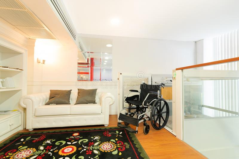 Home lift for disabled or old people in luxury house. Customize home elevator stock photography