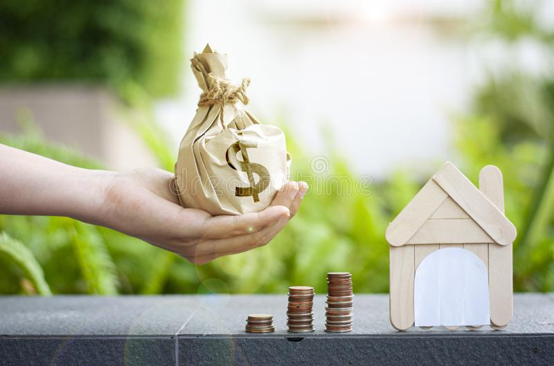 Home loan designs and purse offer each other Save money for buying a home or business investment loan with the real estate concept.  royalty free stock photo