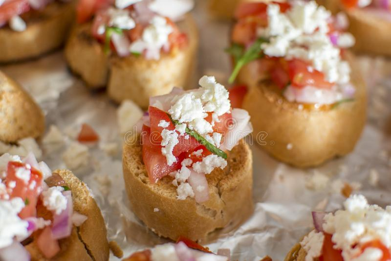 Home made Bruschetta. Bruschetta is an antipasto starter dish from Italy consisting of grilled bread rubbed with garlic and topped with olive oil and salt royalty free stock images