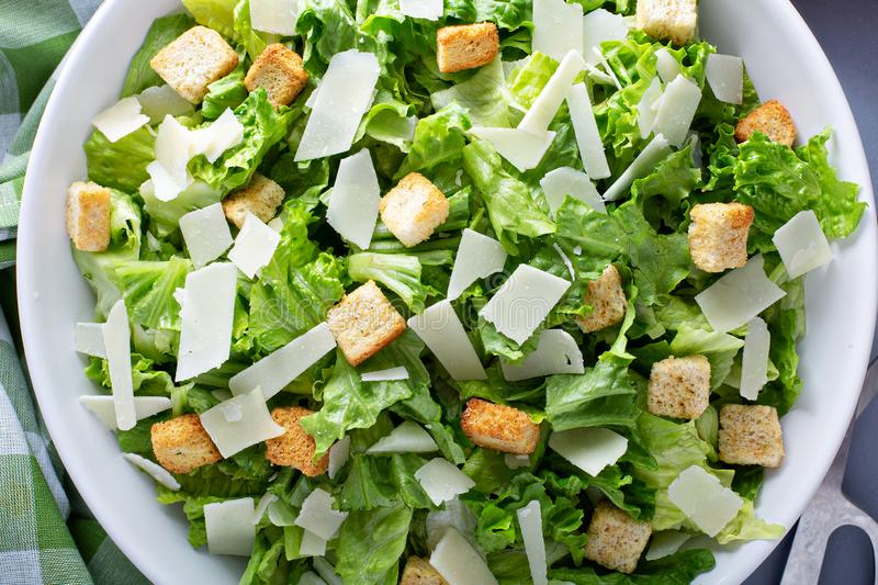 Home made caesar salad. Homemade caesar salad with dressing on the side royalty free stock image