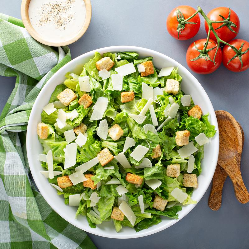 Home made caesar salad. Homemade caesar salad with dressing on the side royalty free stock photos