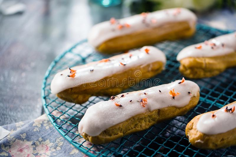 Home made cake eclairs. Traditional eclairs, profitroles classic, eclairs french royalty free stock photos