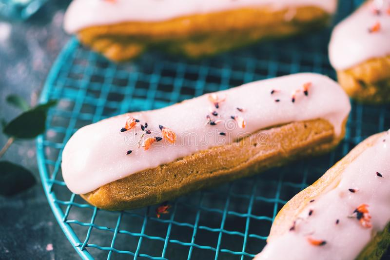Home made cake eclairs. Traditional eclairs, profitroles classic, eclairs french royalty free stock photography