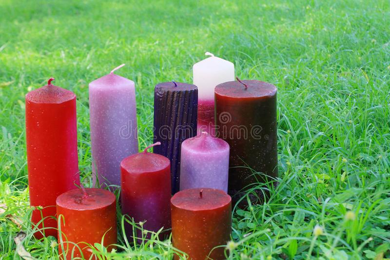 Home made candles in the grass royalty free stock photo
