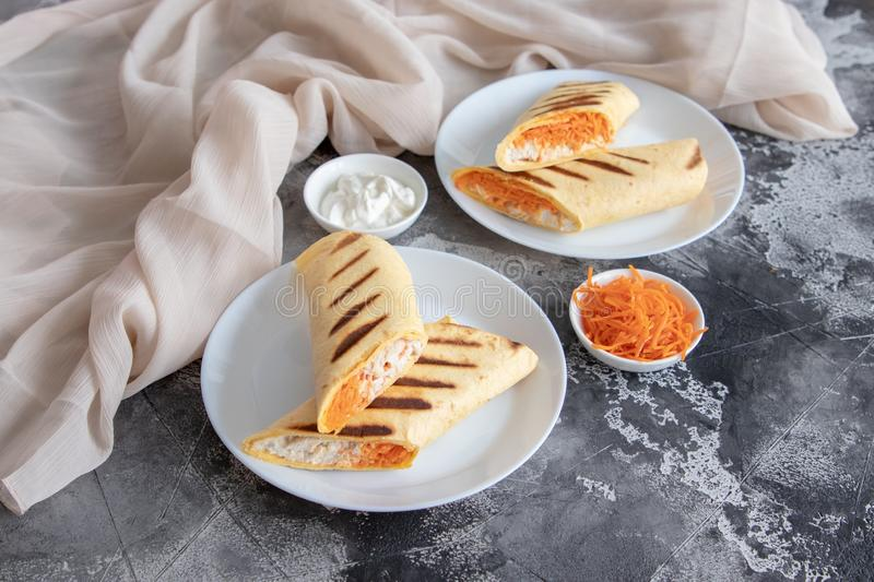 Chicken and carrot roll ups. Home made chicken and carrot roll ups for healthy breakfast or lunch stock images