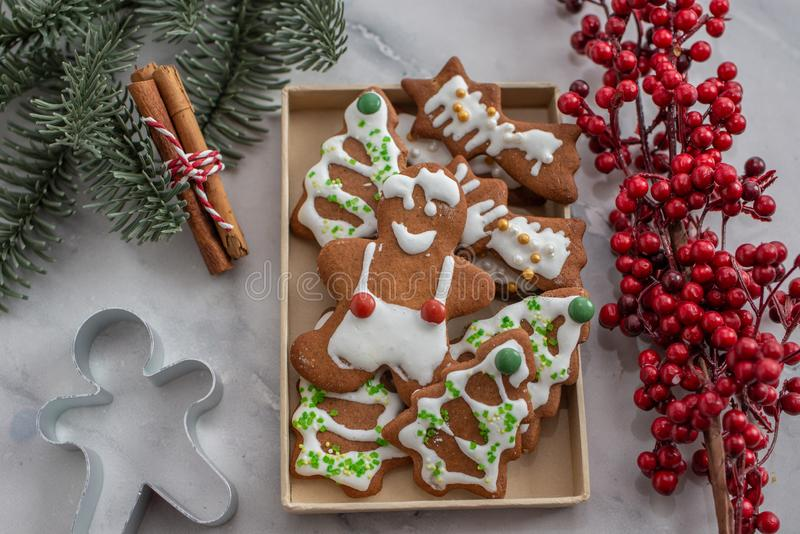 Home made Christmas gingerbread man cookies with a festive background. On a table royalty free stock photography