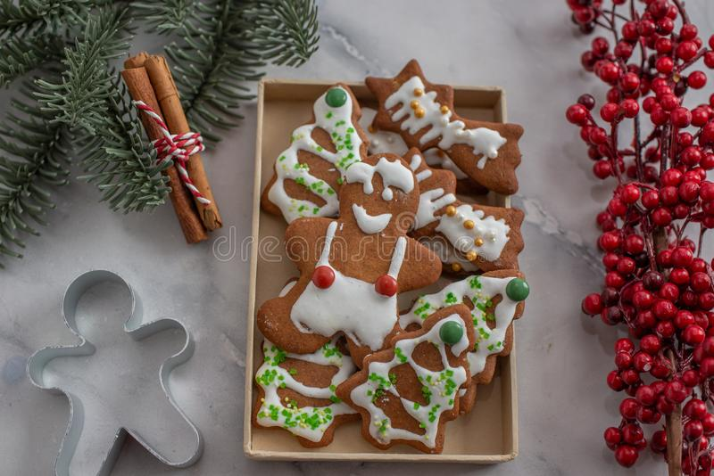 Home made Christmas gingerbread man cookies with a festive background. On a table royalty free stock images