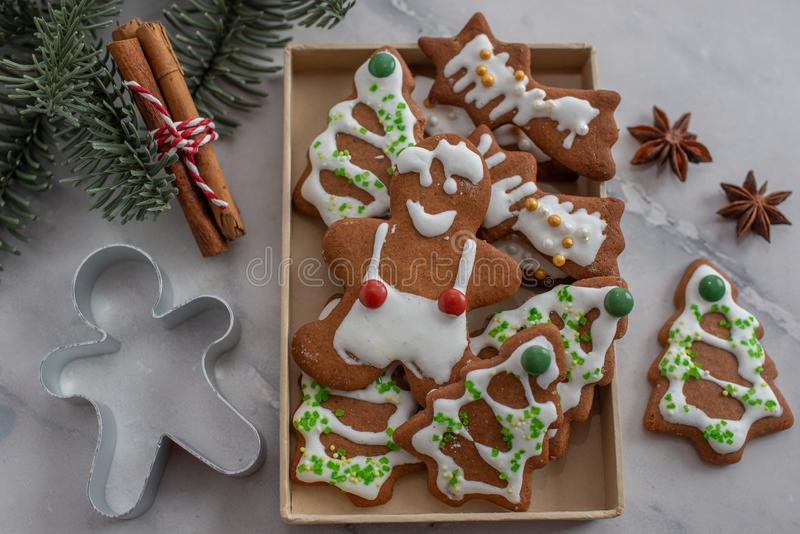 Home made Christmas gingerbread man cookies with a festive background. On a table stock photos