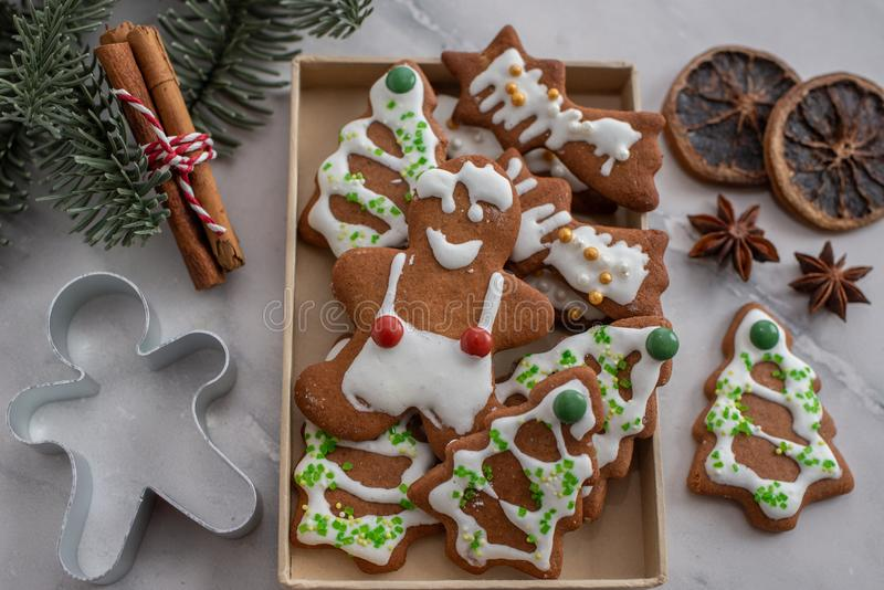 Home made Christmas gingerbread man cookies with a festive background. On a table stock photo