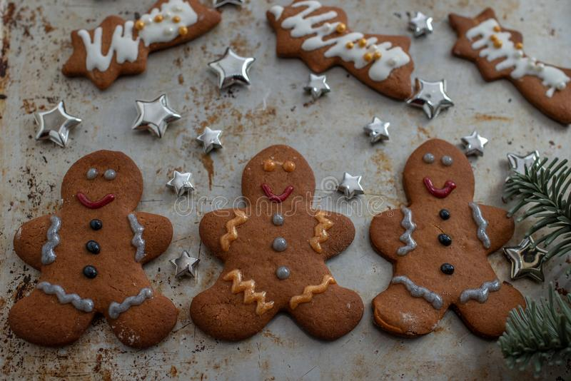 Home made Christmas gingerbread man cookies with a festive background. On a table stock photography