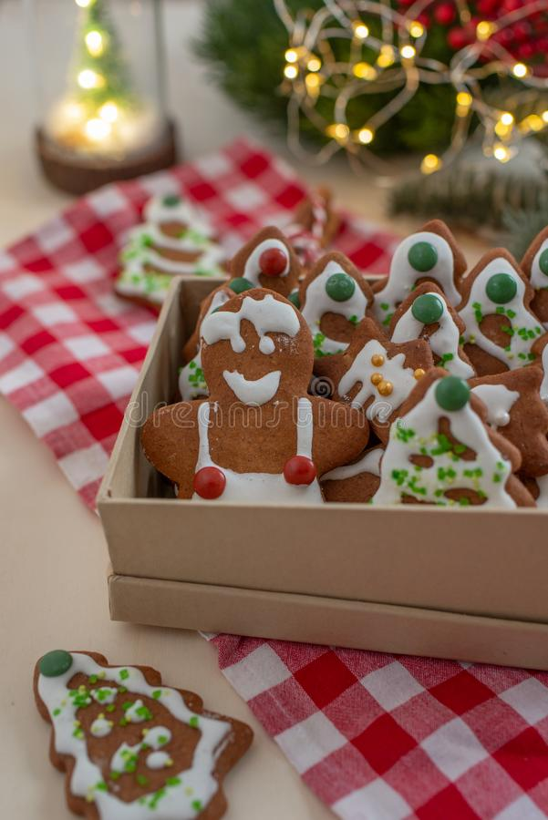 Home made Christmas gingerbread man cookies with a festive background. On a table stock images