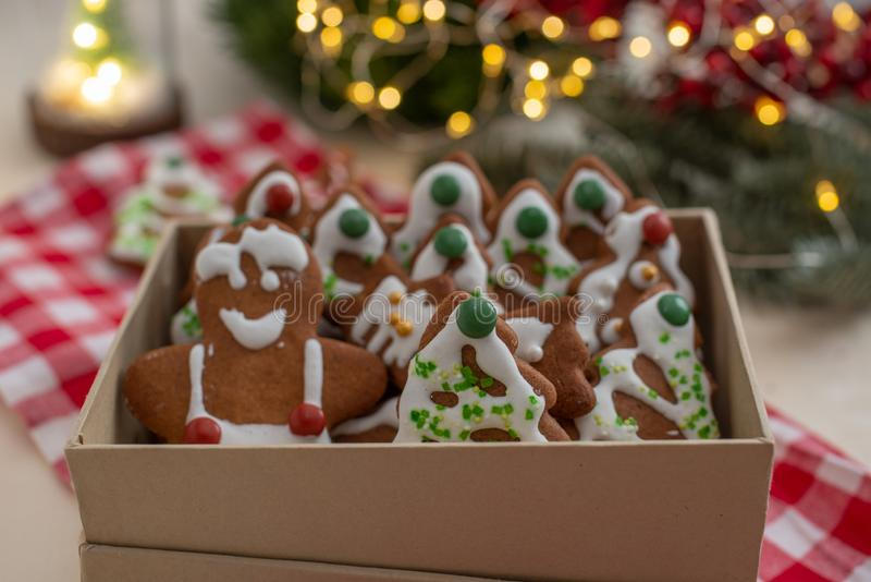 Home made Christmas gingerbread man cookies with a festive background. On a table royalty free stock photo