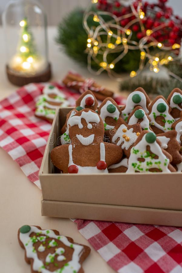 Home made Christmas gingerbread man cookies with a festive background. On a table royalty free stock photos